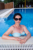 Happy woman in the pool Royalty Free Stock Photography