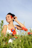 Happy woman with poppy Royalty Free Stock Image