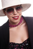 Happy woman portrait. Fashion young woman portrait wearing sunglasses and hat on white background Royalty Free Stock Photos