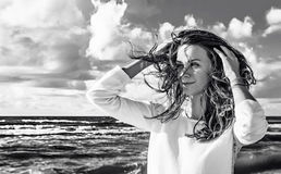 Happy woman. Portrait of a beautiful woman on the beach. Black and white portrait outdoors. Healthy lifestyle. Royalty Free Stock Images