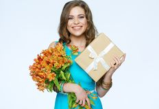 Happy woman portrait with flowers and gift. Royalty Free Stock Images