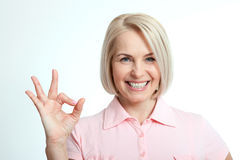 Happy woman portrait. Success.  over white background. Royalty Free Stock Photo