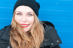 Happy woman portrait wearing winter clothes and hat Stock Photos