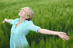 Happy woman. Portrait of young happy woman in a cornfield Royalty Free Stock Image
