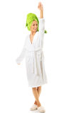 Happy woman posing in bathrobe Royalty Free Stock Photos