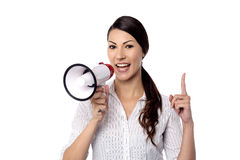 Happy woman posing with megaphone Stock Photography