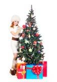 A happy woman posing near the Christmas tree Stock Photos