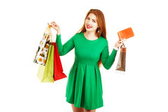 Happy woman posing with shopping bags on a white background Royalty Free Stock Photo