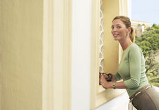 Happy Woman Posing By Wall Stock Photos