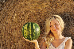 Happy woman posing with watermelon Stock Image