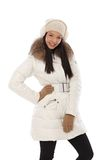 Happy woman posing in white coat Royalty Free Stock Photo