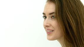 Happy woman posing on white wall stock video footage