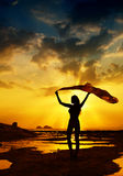 Happy Woman Posting. In Sea Sunset Royalty Free Stock Image