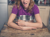 Happy woman with pot in kitchen Stock Photo