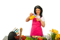 Happy woman pouring orange fresh Royalty Free Stock Images