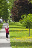 Happy woman power walking royalty free stock photography