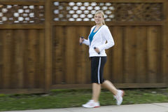 Happy woman Power walking stock images