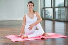 Happy Woman Practicing On Yoga Mat Stock Photography