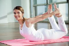Happy Woman Practicing Yoga Stock Image