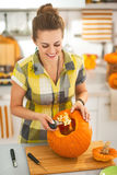 Happy woman prepare big orange pumpkin for Halloween party Royalty Free Stock Image