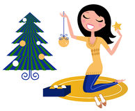 Happy Woman preparing Christmas Tree. Royalty Free Stock Photography
