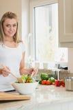 Happy woman preparing salad Royalty Free Stock Image