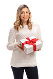 Happy woman with a present Royalty Free Stock Photos