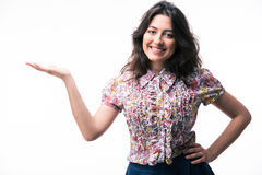 Happy woman presenting copy space on her palm Royalty Free Stock Image