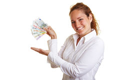 Happy woman presenting fan of Euro Stock Photography