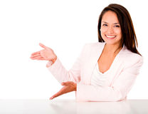 Happy woman presenting something Stock Photo