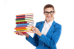 Happy woman presenting stack of books Stock Photos