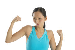Happy Woman Puckering Lips While Flexing Muscles Royalty Free Stock Image