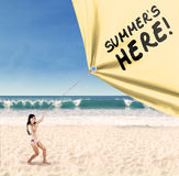 Happy woman pulling a summertime banner Royalty Free Stock Photo