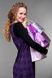 Happy woman with purchases Stock Photo
