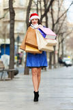 Happy woman with purchases at street Royalty Free Stock Photo