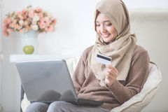 Happy woman purchasing product via online shopping. pay using cr Royalty Free Stock Photography