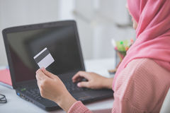 Happy woman purchasing product via online shopping. pay using cr Stock Photography