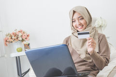 Happy woman purchasing product via online shopping. pay using cr Royalty Free Stock Image
