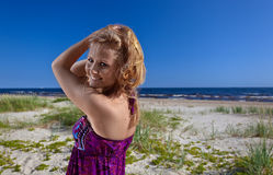 Happy woman in purple sundress Stock Images