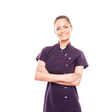 A happy woman in a purple uniform on white Stock Photo