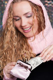 Happy woman with purse and cash Royalty Free Stock Photography