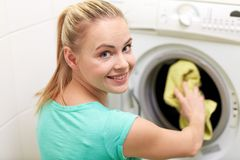 Free Happy Woman Putting Laundry Into Washer At Home Stock Photo - 50188160