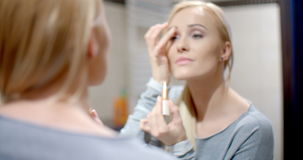 Happy Woman Putting Make up in Front a Mirror stock video footage