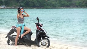 Happy Woman putting off a Helmet on the beach stock footage