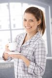 Happy woman in pyjama with coffee cup Royalty Free Stock Images