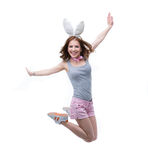 Happy woman in rabbit ears jumping Royalty Free Stock Photo