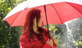 Happy woman in rain Stock Images