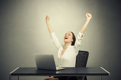 Happy woman with raised arms Royalty Free Stock Photos