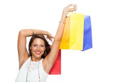 Happy Woman Raising Colored Shopping Bag Stock Image