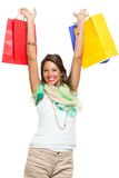 Happy Woman Raising Colored Shopping Bag Stock Photography